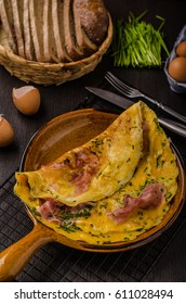 Ham and egg omelette, delicious and simple with fresh bread and herbs chive