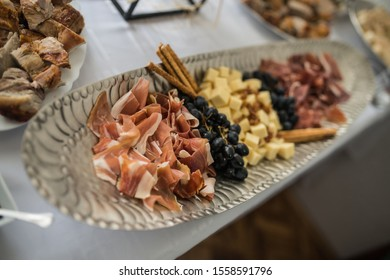 Ham in a pan with grapes and cheese