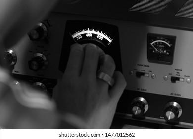 A ham radio operator tuning his equipment.