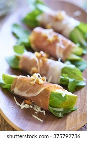 Ham rolls with pear, arugula, nuts and honey