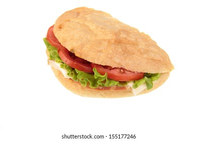 Ham salad sandwich made with freshly sliced bread cut in half with focus on the filling