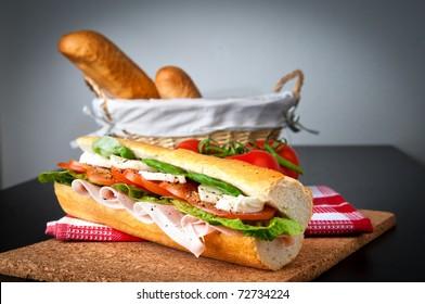Ham, salad and tomato/mozzarella sandwich