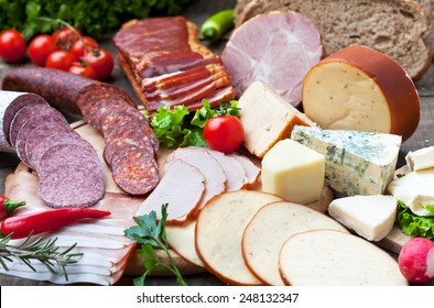 Ham, salami, sausages and cheese with bread and tomato
