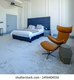 HAMALA, BAHRAIN - MARCH 02, 2019: Interior view of a bedroom with silk carpet and a bespoke leather chair and table in a luxury Middle Eastern villa development.