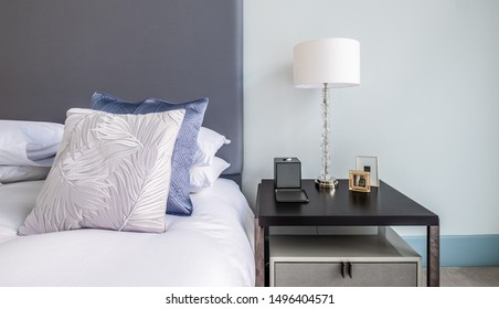 HAMALA, BAHRAIN - MARCH 02, 2019: Interior detail of silk cusions on a bed with a bedside table in a luxury Middle Eastern villa development.