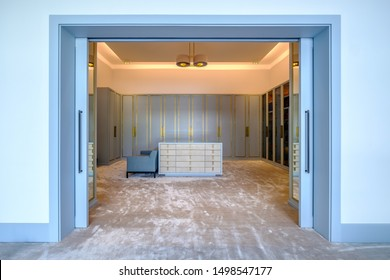HAMALA, BAHRAIN - MARCH 02, 2019: The closets and drawers in a dressing room of a luxury Middle Eastern villa development.