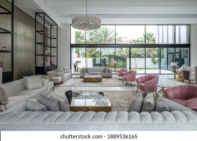 HAMALA, BAHRAIN - MARCH 02, 2019: The large open-plan living area of the interior of a luxury, high-end villa with silk sofas and armchairs and other designer furnishings.