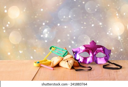 Hamantaschen cookies or hamans ears,noisemaker and mask for Purim celebration (jewish holiday)