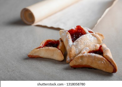 Hamantaschen for Purim holiday and the Scroll of Esther on table