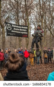 Hambach Forest, NRW/Germany, Dec 11, 2016, 33rd tour through the remaining forest near the RWE opencast mine after massive deforestation for brown coal. Left-wing autonomous named Clumsy rappeling.