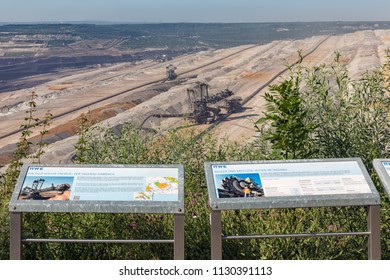 Hambach lignite mine, Germany - June 28 2018: Viewpoint with information panels near Hambach brown coal mine in Germany