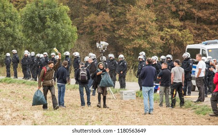 """HAMBACHER FORST, NORDRHEIN-WESTFALEN/GERMANY - SEPTEMBER 16 2018: Two activists coming out of the forest called """"Hambacher Forst"""" who tried to stop the deforestation by sleeping in the forest"""