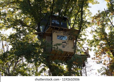 "HAMBACHER FORST, NORDRHEIN-WESTFALEN/GERMANY - SEPTEMBER 30 2018: One of the last treehouses in the ""Hambacher Forst"" with activists living in it who are protesting against the deforestation"