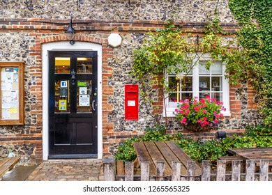 Hambleden, England - 13th August 2015: The old post office and village store. The building is a brick and flint cottage.