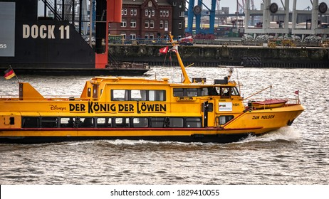 Hamburg, 08.02.2019 - Harbour Scene - yellow taxi boat saying 'the lion king' on the Elbe River