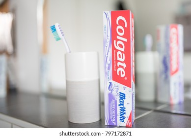 Hamburg, Germany 01.19.2018 illustrative editorial of Colgate Shine Crystals MaxWhite toothpaste in front of bathroom mirror
