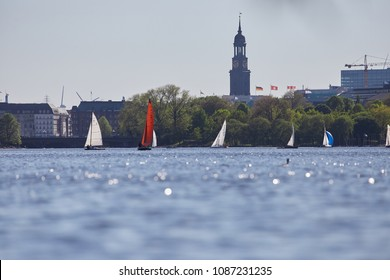 "Hamburg, Germany - 05 06 2018: The Alster in Hamburg with the famous church ""Michel"" in the background on a warm spring day"