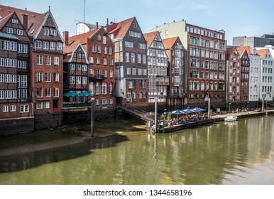 Hamburg, Hamburg, Germany 07-20-2018: historic buildings on bank of Nikolaifleet canal on clear summer day