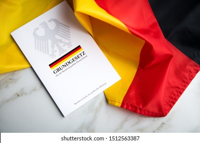 Hamburg, Hamburg / Germany - 09-24-2019: The book of German constitution basic law on flag of federal republic of Germany
