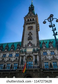Hamburg, Germany - 1. August 2018. View of the townhall with LGBT CSD flag in Hamburg downtown. CSD Rainbow flag on the Hamburg townhall.