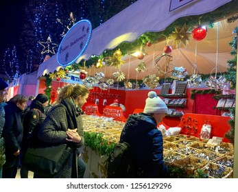 Hamburg, Germany - 11. December 2018. A shop with cookie cutters and decorations on the Christmas market. Visitors on the Christmas market.