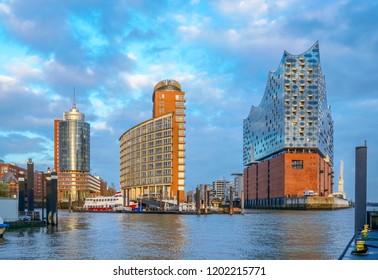 HAMBURG, GERMANY - 2. October 2018. View of the Elbphilharmonie (Elbe Philharmonic Hall) in the Hamburg Hafencity.  Famous Elbphilharmonie in the sunset lights. Herzog & de Meuron architecture.