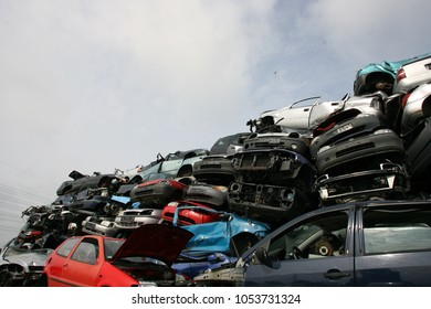 Hamburg, Germany, 2018, stacked and crushed old cars in junkyard, scrap car recycle yard