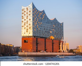 Hamburg, Germany, 22 September, 2018. Tour with the boat in the port at sunset. View at the Elbphilharmonie, a famous concert hall and at the modern hotel