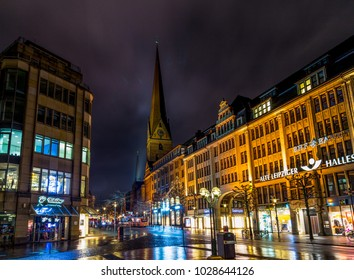 HAMBURG, GERMANY - 30 DECEMBER 2014: View of St. Peter's Church from Moenckeberg street in Hamburg, Germany at foggy winter night