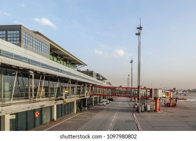HAMBURG, GERMANY - APR 18, 2013: Aircrafts at the gate in the modern Terminal 2 in Hamburg, Germany. Terminal 2 was completed in 1993 and houses Lufthansa and other Star Alliance partners.