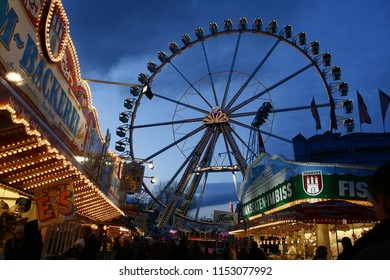 """Hamburg, Germany - April 06, 2008: world's biggest giant wheel at the fairground """"Hamburger Dom"""" just after electric lights have gone on at dawn"""