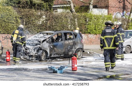 Hamburg, Germany - April 10, 2016: Fire brigade extinguish a burning with road closed