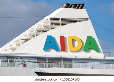 HAMBURG, GERMANY - April 10, 2019: AIDA logo at the funnel of cruise ship AIDAaura. AIDA Cruises is one of ten brands owned by Carnival Corp.