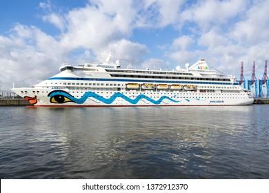 HAMBURG, GERMANY - April 10, 2019: AIDAaura at Cruise Center Steinwerder, one of three passenger terminals for cruise ships in Hamburg. AIDAaura is the third ship operated by AIDA Cruises.