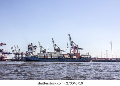 HAMBURG, GERMANY - APRIL 19, 2015: A container ship is in a container terminal in the harbor of hamburg, Germany. A ship lies not more than one day in the terminal.