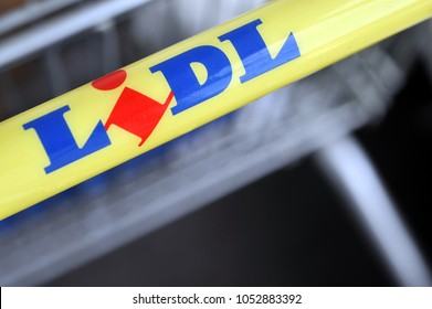 Hamburg / Germany - April 3, 2017: Handle of a shopping cart with the logo of LIDL -  Lidl is a german global discount supermarket chain - Hamburg, Germany