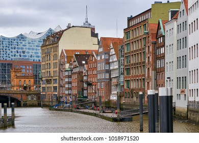 Hamburg, Germany - April 7, 2017: View of the Elbphilharmonie in the middle of traditional Hamburg buildings
