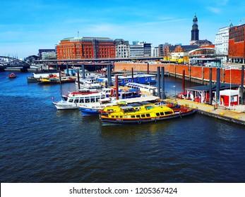Hamburg, Germany - April 7, 2018: View of river Elbe,  colorful ships, Hamburg bridges and harbor from Kehrwiedersteg