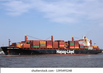 HAMBURG, GERMANY - APRIL 7, 2019: Container ship Hapag-Lloyd Yorktown Express on the river Elbe leaving the Port of Hamburg