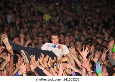 HAMBURG, GERMANY - AUGUST 15, 2014: German DJ and producer ALLE FARBEN doing a stage dive at MS Dockville Festival on August 15, 2014 in Hamburg.