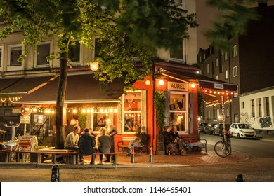 HAMBURG, GERMANY - AUGUST 15, 2016: Famous bar in Altona with people sitting and drinking