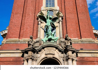 Hamburg, Germany - August 2, 2018  - St. Michael's Victory over the Devil, sculpture above the main entrance to St. Michael's Church in Hamburg