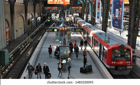 HAMBURG, GERMANY - AUGUST 28, 2014: Travelers board the train at Central Railway Station (Hauptbahnhof) in Hamburg. With 450,000 daily passengers it is the 2nd busies station in Europe.