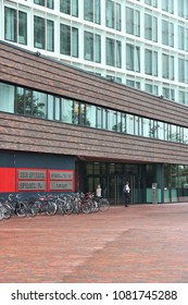HAMBURG, GERMANY - AUGUST 29, 2014: People visit Der Spiegel magazine office in Hamburg. It is one of largest news magazines in Europe with circulation of 1 million per week.