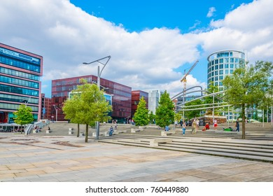 HAMBURG, GERMANY, AUGUST 29, 2016: People are strolling thorugh the hafencity district in Hamburg, Germany.