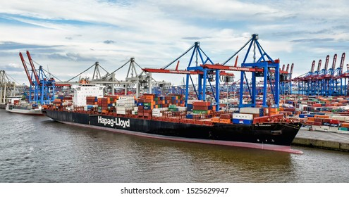 Hamburg, Germany - August 4, 2018: A Hapag-Lloyd container ship has moored at the Finkenwerder terminal in the Port of Hamburg and is being loaded and unloaded.