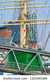 """Hamburg, Germany - August 8, 2018: View of the historic sail ship """"Rickmer Rickmers"""" with the concert hall Elbphilharmonie in the harbor."""
