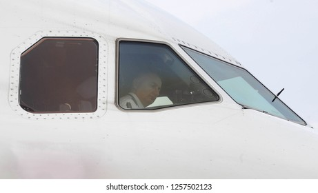 HAMBURG, GERMANY - CIRCA JUNE 2016: Air Serbia Airbus A320 captain pilot standing on tarmac preparing plane for departure
