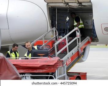 HAMBURG, GERMANY - CIRCA JUNE 2016: Ground handling operations and baggage loading before flight, circa June 2016 in Hamburg