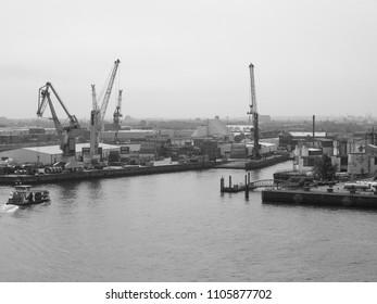 HAMBURG, GERMANY - CIRCA MAY 2017: Hamburger Hafen (Port of Hamburg) sea port on the river Elbe in black and white